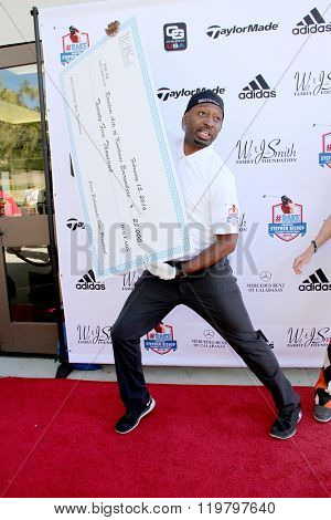 Ricky Smith with a donation (Will and Jada Smith Foundation) at the inaugural Stephen Bishop celebrity golf invitational benefiting R.A.K.E., Feb. 15, 2016 at Calabasas Country Club in Calabasas, CA.