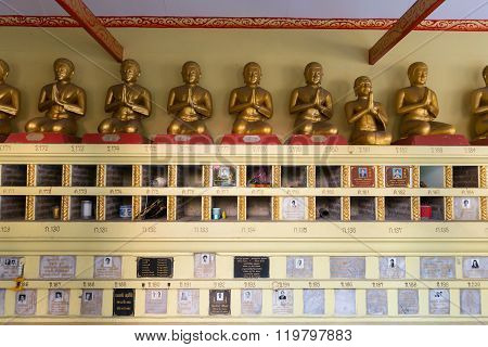 Memorial Plaques Mounted On A Wall Inside Buddhist Temple