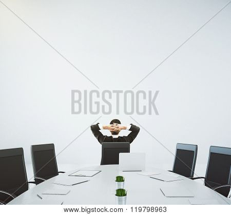 Businessman Resting On The Chair In Conference Room With Oval Table And Chairs, 3D Render