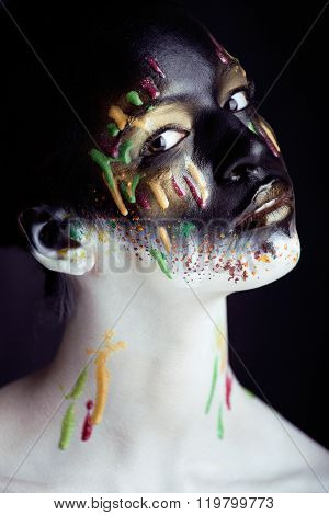 woman with creative makeup closeup like drops of colors, facepaint close up halloween
