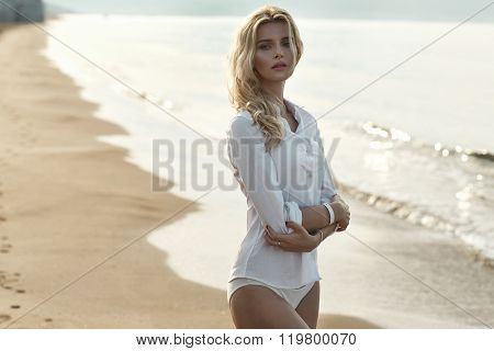 Closeup portrait of a tanned blond lady in tropics