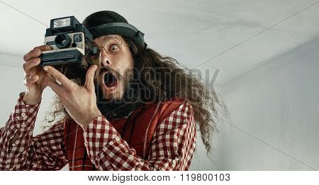 Skinny funny guy taking a photograph