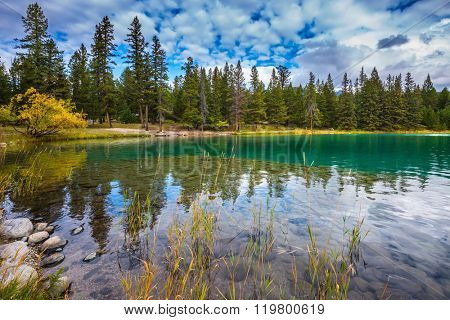 Canadian Rocky Mountains, Jasper National Park. The picturesque oval lake with clear water
