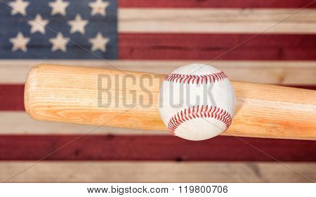 Ball Hitting Wooden Bat With Faded Boards Painted In American Usa Flag Colors