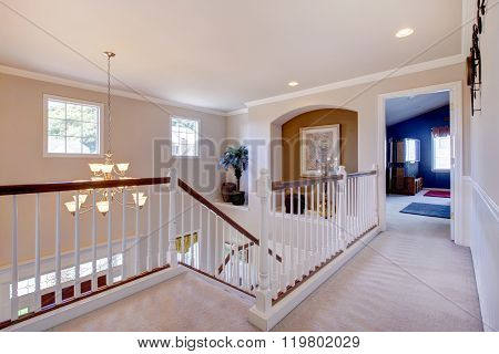 Btight Hallway With Elegant White Interior, And Carpet.
