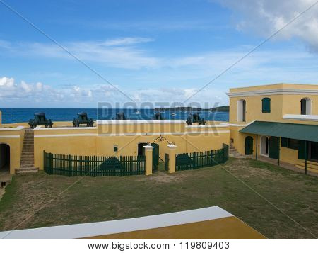 Ft. Christiansted Courtyard With Cannons On The Front Wall