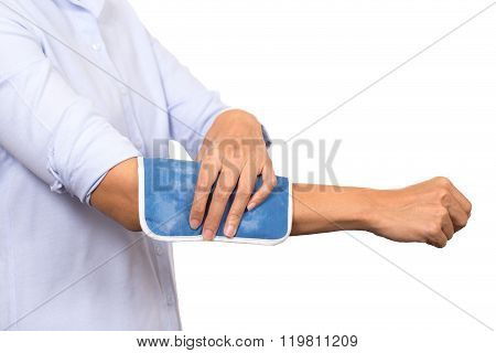 Business Woman Putting An Ice Pack On Her Arm Pain