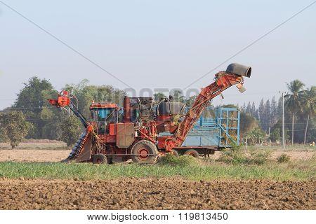 sugarcane harvester and ten-wheel tractor