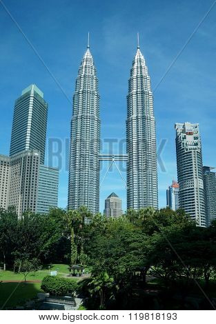 KUALA LUMPUR, MALAYSIA - NOVEMBER 22, 2015: The Petronas Twin Towers at KLCC City Center on a clear day and blue sky.