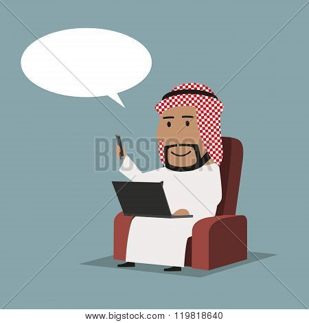 Arab businessman with laptop and smartphone