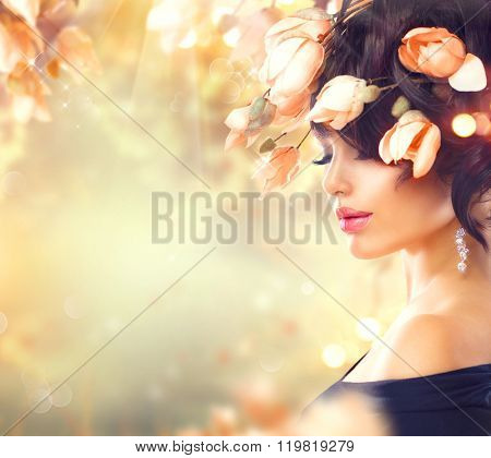 Spring Woman with flowers in her hair. Beauty Lady portrait Fashion Brunette Girl with Magnolia Flowers Hairstyle. Flowers in hair. Beautiful model girl with perfect make up