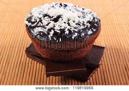 Muffins With Desiccated Coconut On Pieces Of Chocolate
