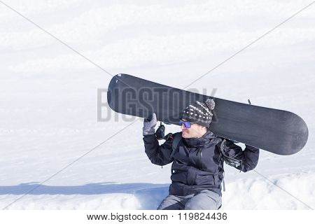 Adult Man Holding Snowboard On Neck