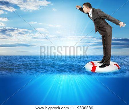 Buisnessman on lifebuoy