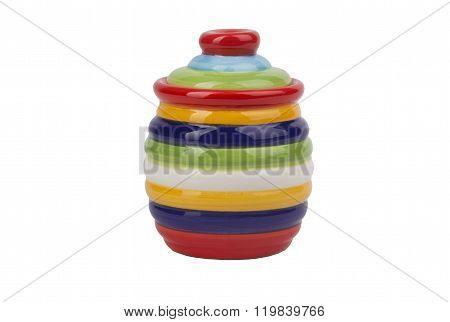 Earthen pot painted with colour stripes.