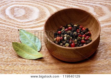 Colorful pepper and bay leaves.