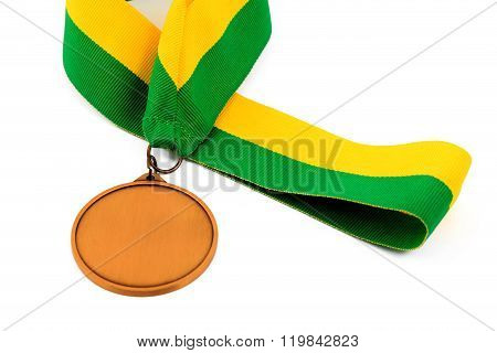 Gold medal on white background with blank face for text, Gold medal in the foreground on yellow gree
