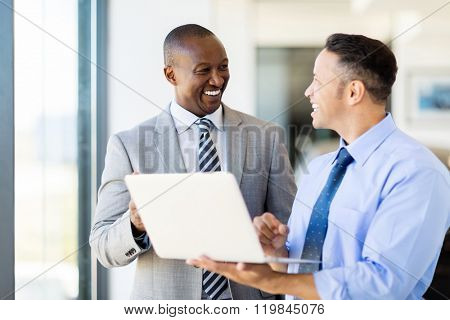 multiracial business people using laptop in modern office