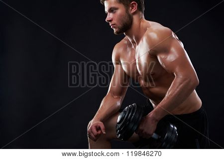 Young fitness man in studio