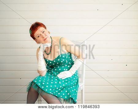 Attractive Adult Woman Sitting On Chair