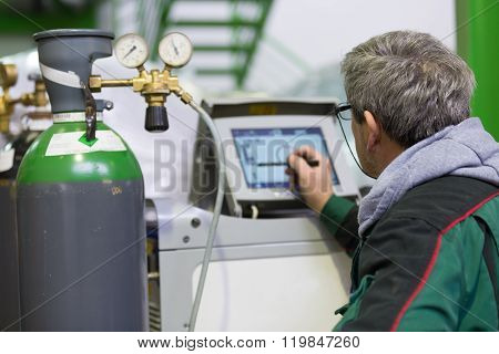 Industrial worker setting orbital welding machine.