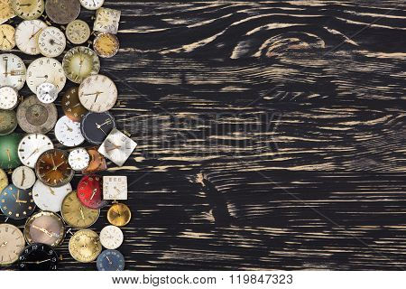 Old watches on a dark wooden  background.