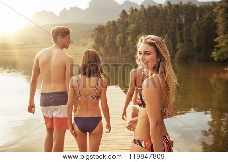 Beautiful Girl With Friends And Walking On The Jetty