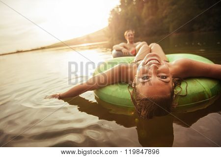Young Girl In Lake On Innertube