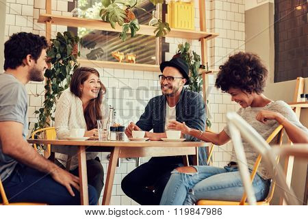 Group Of Friends Enjoying In Cafe