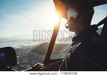 Helicopter Pilot Flying Aircraft Over A City