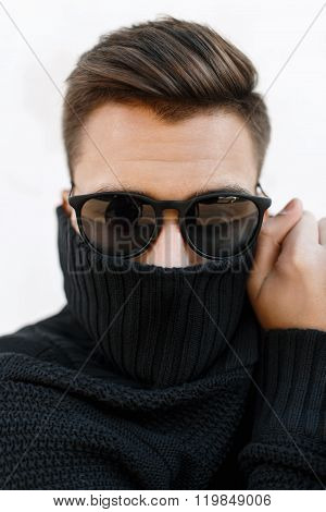 Close-up Fashion Portrait Of A Young Handsome Guy With Stylish Hairstyle In Sunglasses And Knitted S