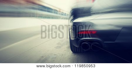 transportation, speed, racing and road concept - close up of car riding on highway from back