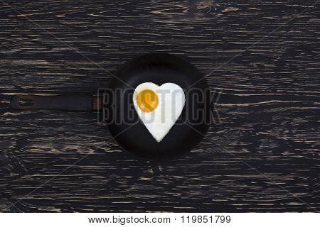 Fried egg Heart shape on the pan