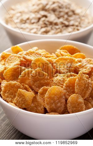 Cornflakes And Oatmeal In White Bowls Vertical