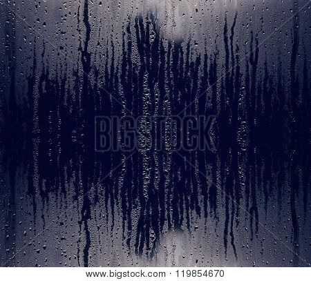 Water and rain drops on the glass, abstract view, Drops of rain on blue glass background / drops on