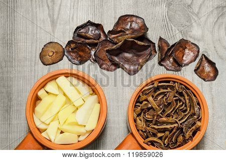 Dried mushrooms and potatoes, sliced for cooking