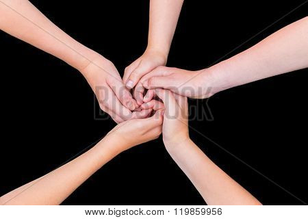 Five Teenage Arms With Hands Entangled Isolated On Black Background
