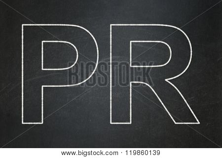 Advertising concept: PR on chalkboard background