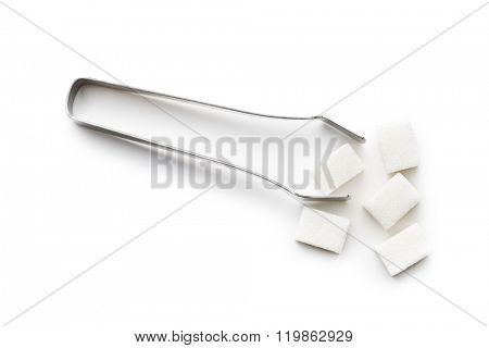 sugar cubes and sugar tongs on white background
