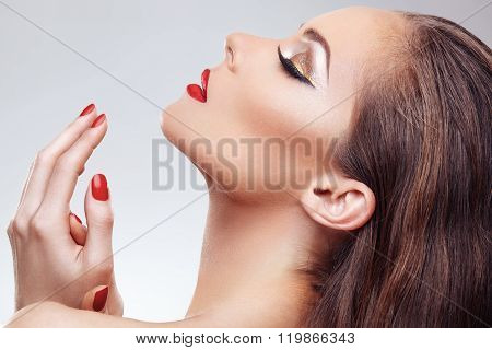 Closeup Of Beautiful Woman Face With Nice Makeup And Red Nails