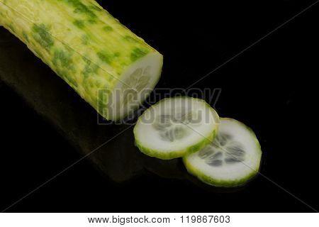 Cucumber Sliced On Black Background