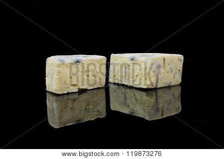 Two Pieces Blue Cheese On Black Background