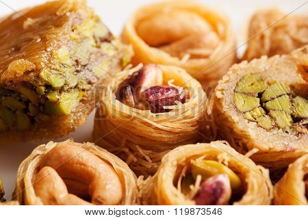Oriental Sweets In Shape Of Nest With Nuts Close-up
