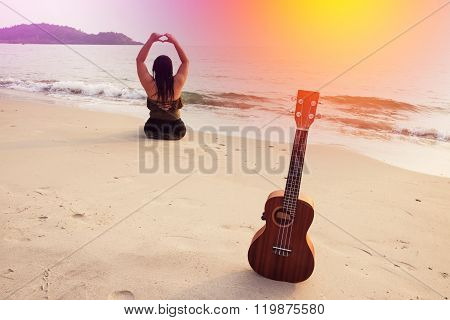 Beach, sun, sea and sand and woman with ukulele