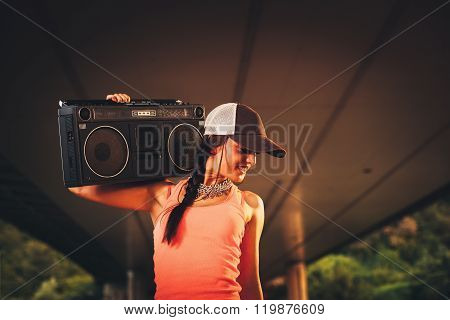 Hip Hop Woman Holding A Tape Recorder On Shoulder