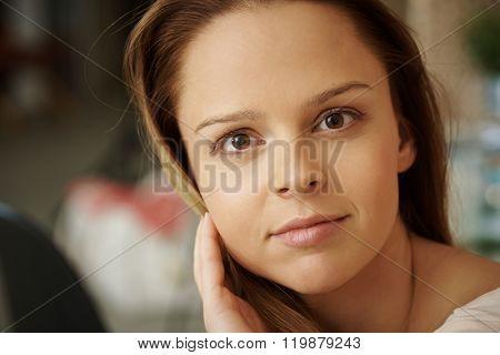 Closeup portrait of natural young woman looking at camera.