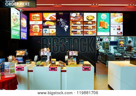 PATTAYA, THAILAND - FEBRUARY 20, 2016: inside of McDonald's restaurant. McDonald's primarily sells hamburgers, cheeseburgers, chicken, french fries, breakfast items, soft drinks, milkshakes, desserts
