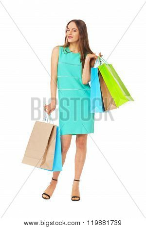 Fullbody Portrait Of Beautiful Woman With Bags Isolated On White.