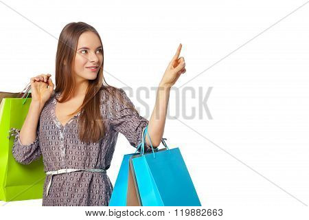 Happy Beautiful Woman With Shopping Bags Isolated On White.