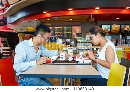 PATTAYA, THAILAND - FEBRUARY 25, 2016: people eat at McDonald's restaurant. McDonald's is the world's largest chain of hamburger fast food restaurants